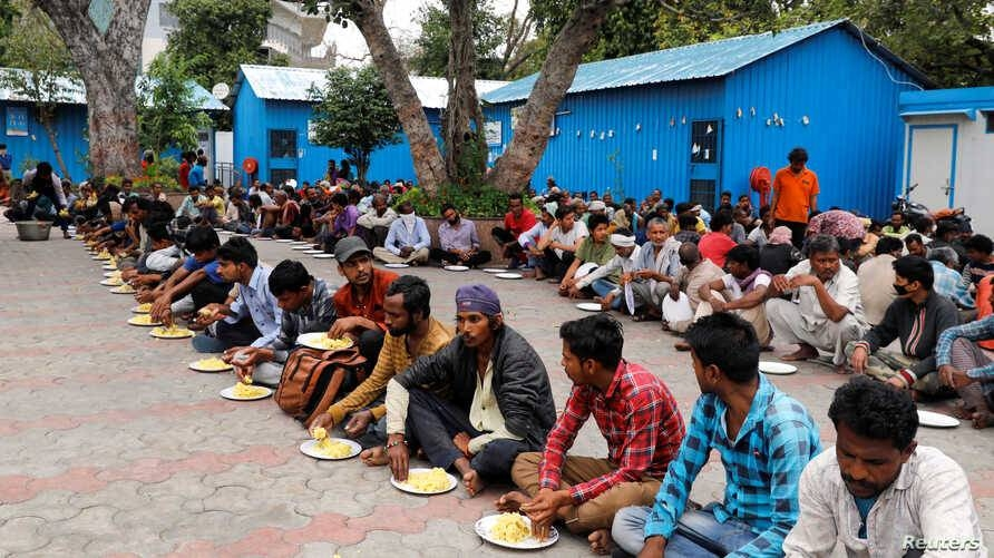 Daily wage workers and homeless people eat food inside a government-run night shelter during a 21-day nationwide lockdown to prevent the spread of coronavirus in the old quarters of Delhi, India, in this March 26, 2020 file picture. — Courtesy photo