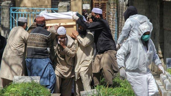 People move a coffin of a man who died due to coronavirus disease (COVID-19), for a burial at graveyard in Abbottabad, Pakistan, in this file picture. — Courtesy photo