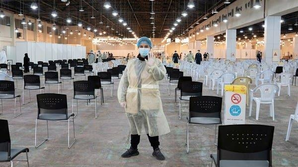 A volunteer, who directs visitors at a coronavirus testing center, gestures at the Kuwait International Fairgrounds in Mishref, Kuwait. -- Courtesy photo