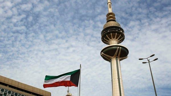 The Liberation Tower is seen near a Kuwaiti flag in Kuwait City. -- Courtesy photo