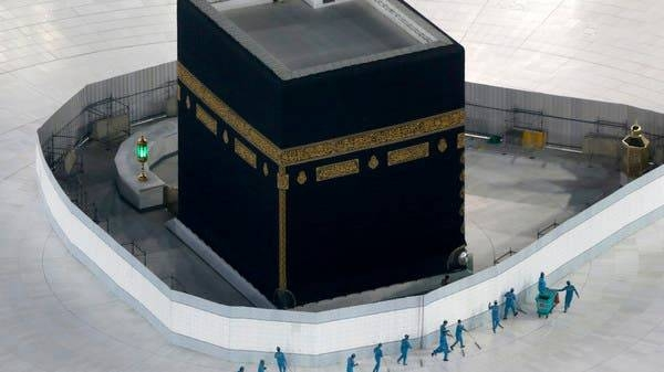 Workers disinfect the ground around the Ka'ba, the cubic building at the Grand Mosque, in the holy city of Makkah.-- Courtesy photo