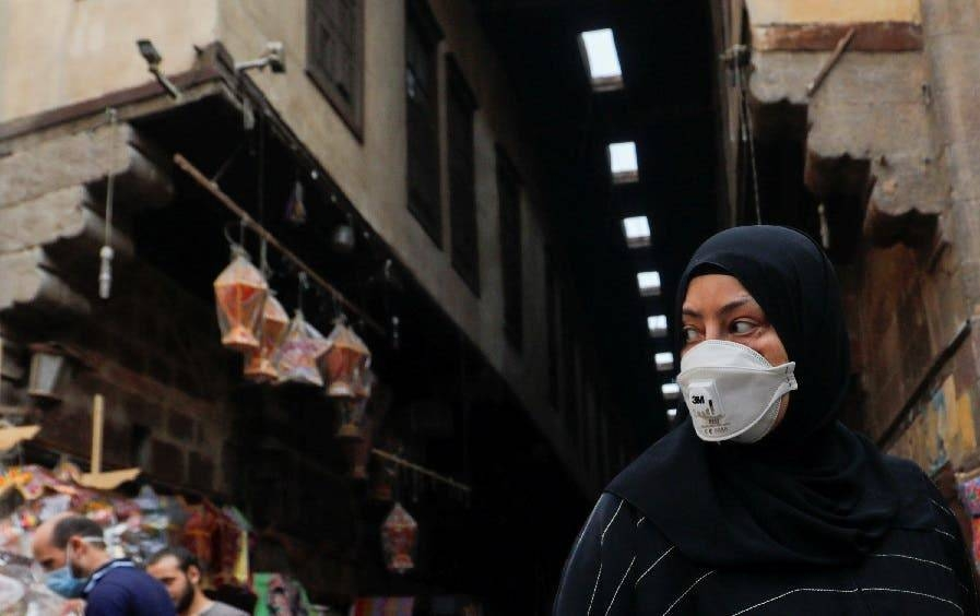 A woman wearing a protective face mask, amid concerns over the coronavirus, looks at traditional Ramadan lanterns, ahead of the Muslim holy month of Ramadan at Al-Khayamia Street in Old Cairo, Egypt. — Courtesy photo