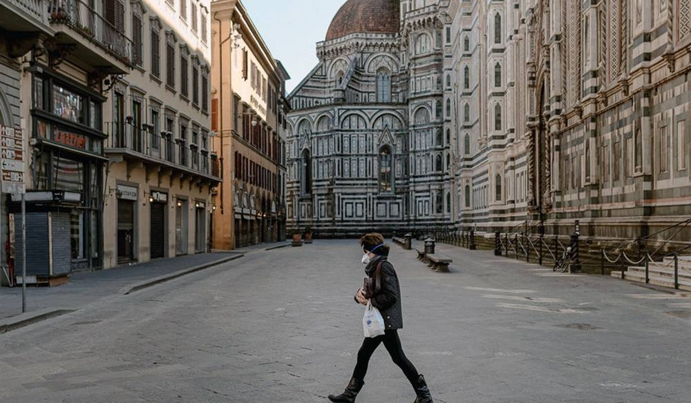 A lone pedestrian in Piazza Del Duomo, a space normally crowded with thousands of visitors. — UN courtesy photo by Francesco Spighi (www.francescospighi.com)