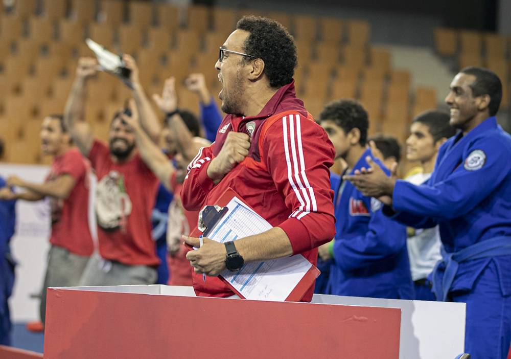 Faisal Al Ketbi celebrates his fighter's victory with a euphoric roar