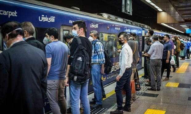 People in face masks at a subway station in Tehran. -- Courtesy photo