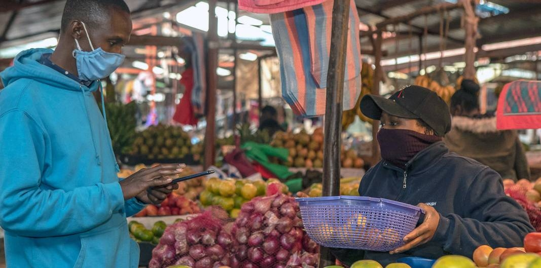 A man in Kenya shops for produce as the coronavirus pandemic brings into focus the interdependence between humanity and biodiversity. — courtesy World Bank / Sambrian Mbaabu