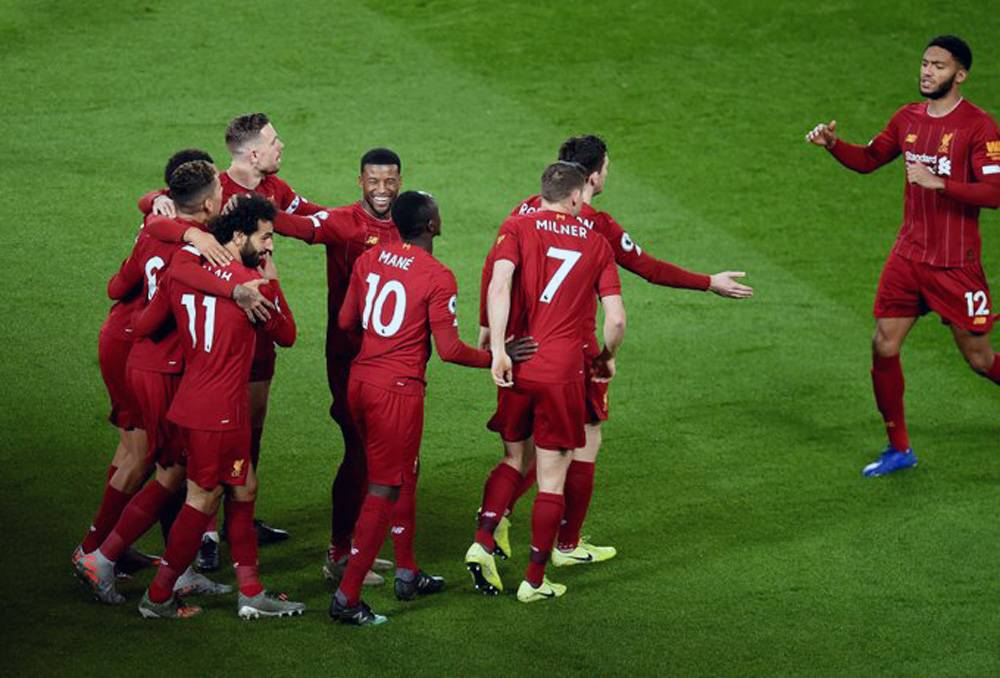 Liverpool players celebrate after being crowned Premier League champions, winning their first title in 30 years.
