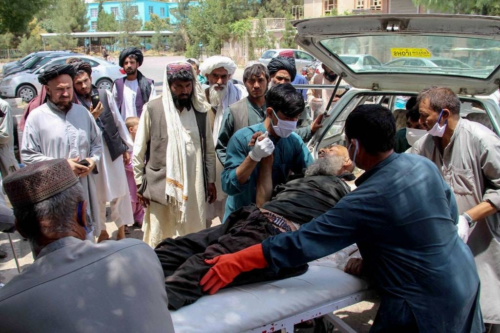 People tend to an aged man who was injured in Monday's blasts. — Courtesy photo
