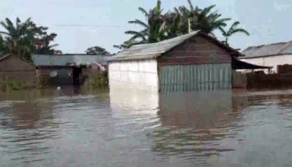 Picture shows villages in Assam are under water following incessant rains. — courtesy ANI
