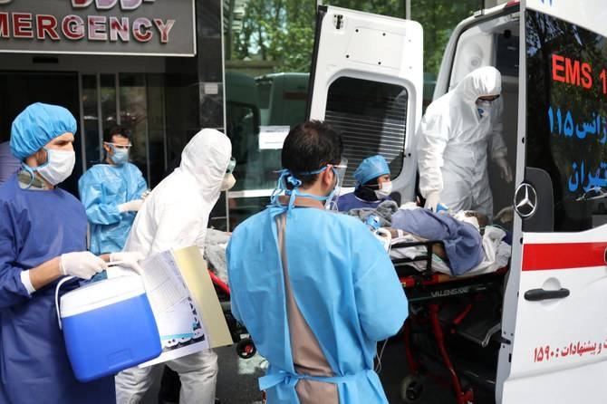 Emergency medical staff and nurses transfer a patient with coronavirus to Masih Daneshvari Hospital in Tehran in this file photo.