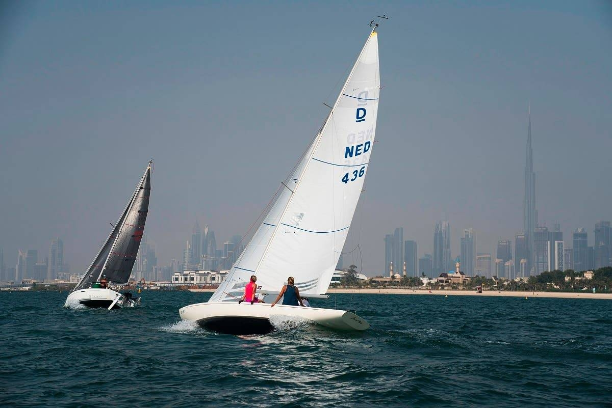 Sailboats taking part in a race catch the wind with the Burj Khalifa, the world's tallest building, seen in the distance in Dubai. — File photo