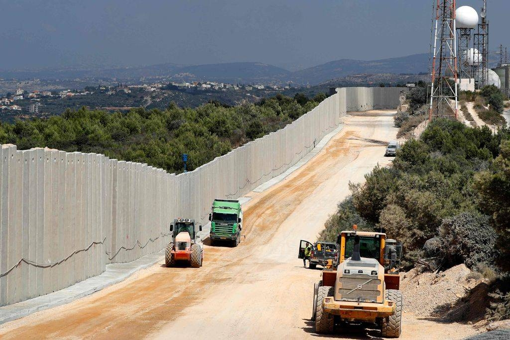 Tractors are seen along a new wall on the Israeli-Lebanese border near the Rosh Hanikra border crossing. — File photo