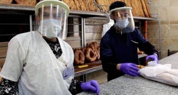 Vendors in a bakery in Constantine, Algeria, during the COVID-19 crisis. — courtesy ILO/Yacine Imadalou