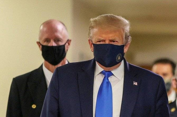 US President Donald Trump wears a mask while visiting Walter Reed National Military Medical Center in Bethesda, Maryland, Saturday. — Courtesy photo