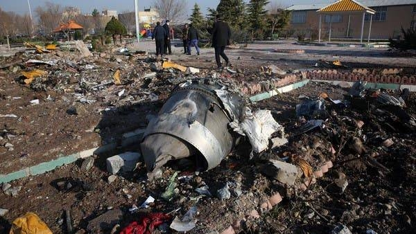 Rescue teams work amidst debris after a Ukrainian plane crashed near the airport in Tehran — File photo