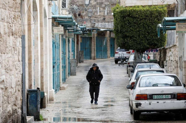 A man walks past closed shops as preventive measures are taken against the coronavirus, in Bethlehem in the Israeli-occupied West Bank. — Courtesy photo