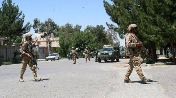 Afghan security forces take position during a fighting outside a government compound in the city of Lashkar Gah. — File photo: AP