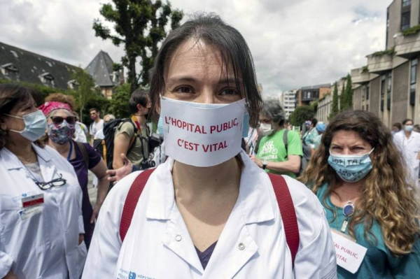 A health worker demonstration in Paris, France, June 2020. — courtesy Martin Barzilai / HAYTHAM-REA / Redux