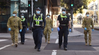 Residents of Melbourne, Australia's second-biggest city and the capital of Victoria, are now under an overnight curfew, non-essential businesses are closed and face coverings are mandatory as hundreds of new cases are recorded daily. — Courtesy photo