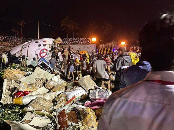 The wreckage of an Air India Express Flight IX 1344 from Dubai to Kozhikode after the plane had overshot the runway while landing around 7:40 p.m. (IST) on Friday. — Courtesy photo