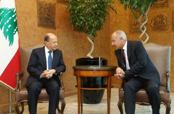 Arab League Secretary General Ahmed Aboul Gheit speaks with President Michel Aoun in this file photo
