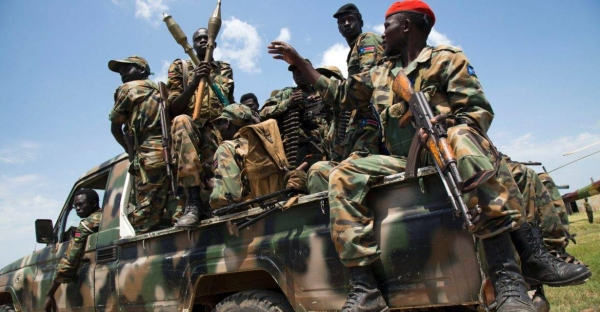 South Sudanese soldiers sit in a pick-up truck at the military base in Malakal, northern South Sudan in this file photo.