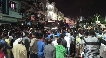 Protesters gather outside a police station in the south Indian city of Bengaluru on Tuesday night, seeking action against an objectionable Facebook post. — Courtesy photo