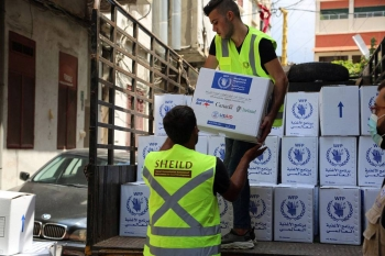 Workers unload WFP food aid at the Karageusian Center in Beirut, Lebanon. — courtesy  WFP/Ziad Rizkallah