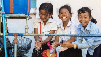 Girls at a school in Cambodia wash their hands using water from a school WASH facility. — courtesy UNICEF/Bona Khoy