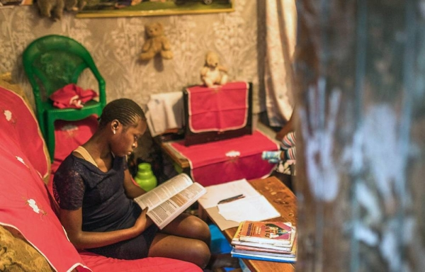 A primary school student studies at home in Kibera, Kenya. — courtesy UNICEF/Brian Otieno