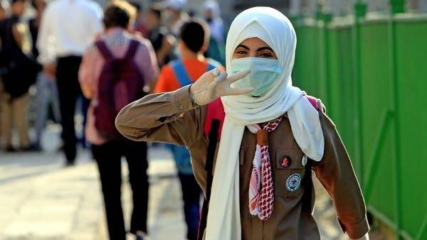 A student attends the first day of school on Tuesday while wearing a protective mask and gloves in Amman amid the ongoing coronavirus pandemic. — Courtesy photo