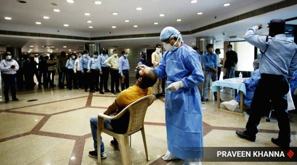A team of health workers takes swab samples for COVID-19 test of Civic Center staff in New Delhi on Tuesday. — Courtesy photo