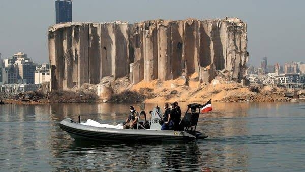 Lebanese and French troops ride a boat past the damaged grain silo near the site of the massive blast in Beirut's port area. — File photo
