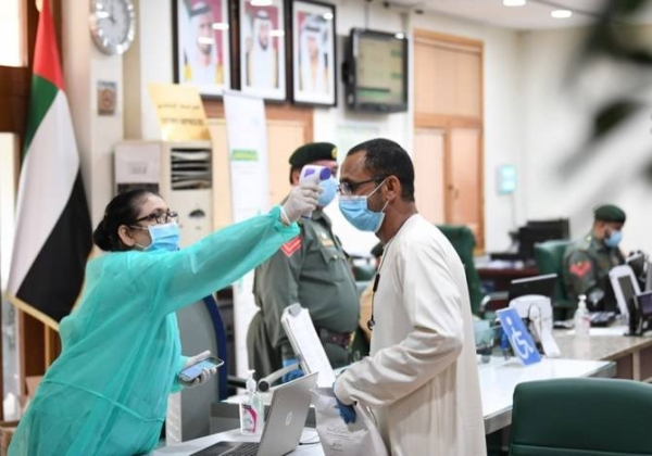 A man has his body temperature reading taken in Dubai in this file photo
