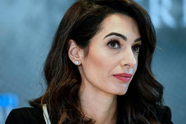 Human rights lawyer Amal Clooney said she is quitting her role as the UK's special envoy over her opposition to the British government's suggestion it could break international law in the event it fails to agree on a trade deal with the European Union.