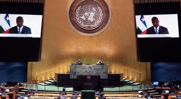 Faustin Archange Touadera (on screen) of the Central African Republic addresses the general debate of the General Assembly's seventy-fifth session. — courtesy UN Photo/Evan Schneider