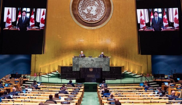 Prime Minister Justin Trudeau (on screen) of Canada addresses the general debate of the General Assembly's seventy-fifth session. — courtesy UN Photo/Rick Bajornas