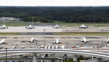 File photo taken on Sept. 11, 2020, shows passenger planes parked on a taxiway at Narita airport near Tokyo. (Kyodo)
