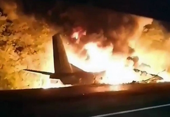 In this TV grab released by Ukraine's Emergency Situation Ministry, an AN-26 military plane bursts into flames after it crashed in the town of Chuhuyiv, Ukraine on Friday. — courtesy Emergency Situation