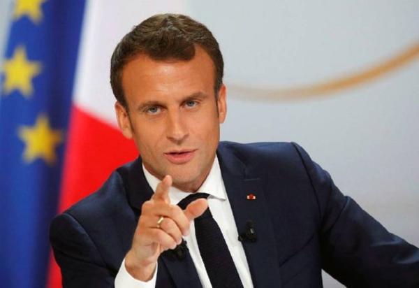 French President Emmanuel Macron making a point.