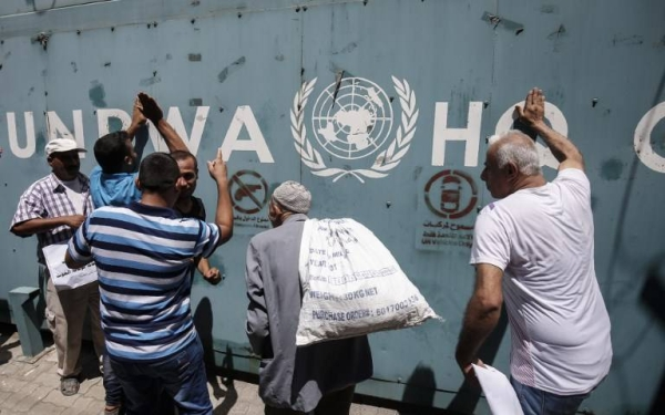 Employees of the UN Relief and Works Agency for Palestine Refugees in the Near East (UNRWA) and their families protest against job cuts announced by the agency outside its offices in Gaza City in this July 31, 2018 file picture.
