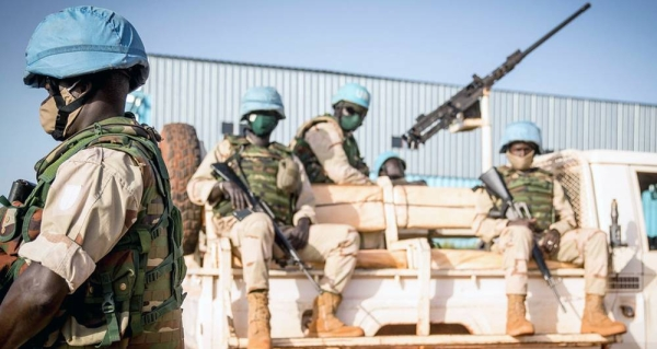 Peacekeepers serving with the UN's Multidimensional Integrated Stabilization Mission in Mali (MINUSMA) wear face masks while on patrol. — courtesy MINUSMA/Harandane Dicko