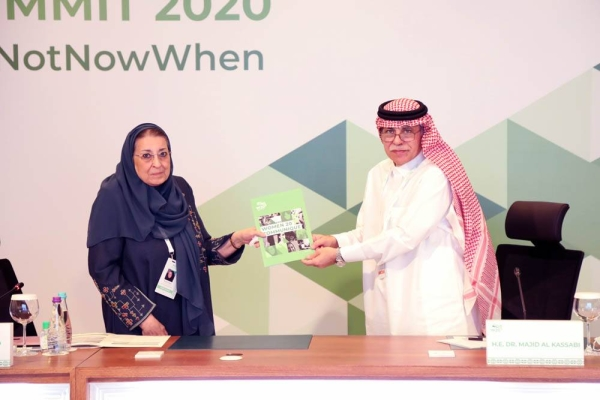 Dr. Majid Al Qasabi, minister of commerce, chair of G20 Trade and Investment, representing the Presidency of the G20 receives the W20 Communiqué from Dr. Thoraya Obaid, W20 Chair.