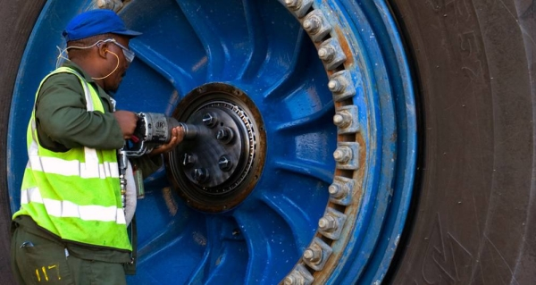 A worker repairs a wheel of a giant haul truck at a uranium mine in Namibia. —courtesy World Bank/John Hogg