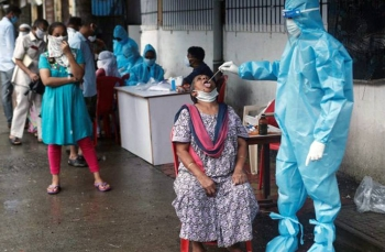 Health workers test Indian waiting in line for coronavirus. India has the second-highest number of infections in the world, after the United States, but the rate of increase in India has dipped since it hit a peak in September.