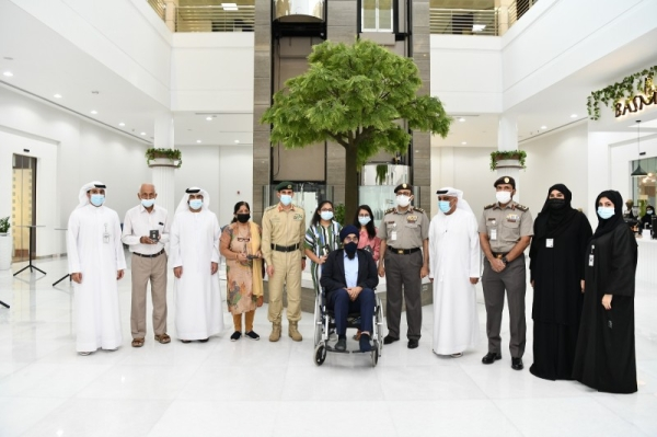Lt. Gen Al Marri handed over the golden visas to the two sisters and their grandparents when he received them at the General Directorate of Residency and Foreigners Affairs in Dubai headquarters. — WAM photo