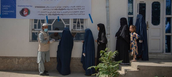 Women impacted by the COVID-19 pandemic wait to receive cash assistance from the World Food Programme in Kabul, Afghanistan, in this file picture. — Courtesy photo