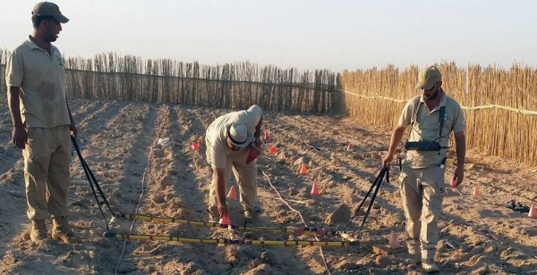 A team of mien clearance experts searches for cluster bombs in a plowed field in Iraq. — courtesy DMA/RMAC-S Iraq