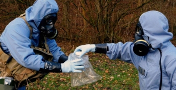 OPCW inspectors, in full protective gear, collecting samples during a mock exercise. — courtesy Photo OPCW