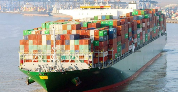 A container ship unloads its cargo at a port. — courtesy IMO